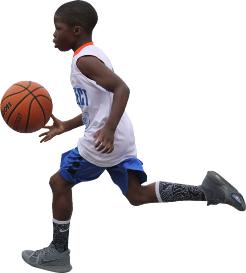 Photo of a Kid Playing Basketball
